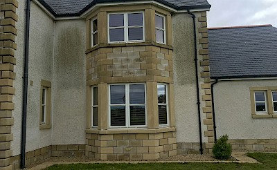 efflorescence removal and render cleaning front midway